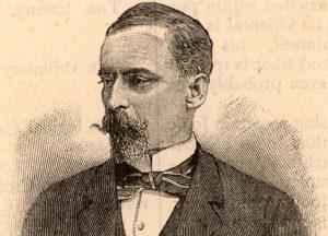Czarno-buały portret mężczyzny zbrodą isumiastymi wąsami. Ubraby wbiałą koszulę zestójką ikokardę